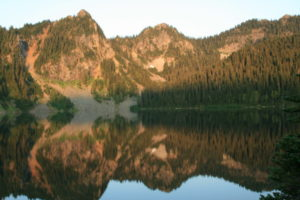Still waters of Marmot Lake cast mirrorlike reflections