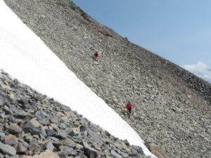 We look like ants crossing a tricky section of loose rock...