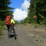 """Greg on the """"road"""" to Dosewallips CG, you can still see the old road signs..."""