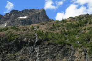 You can see the distinctive crater that forms the top of the mountain, and the long braided waterfalls that cascade off its shoulders
